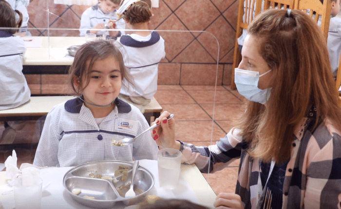 student eats the menu of the gluten-free day at the school cafeteria