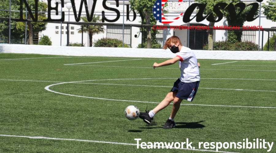 student playing soccer in the school soccer field