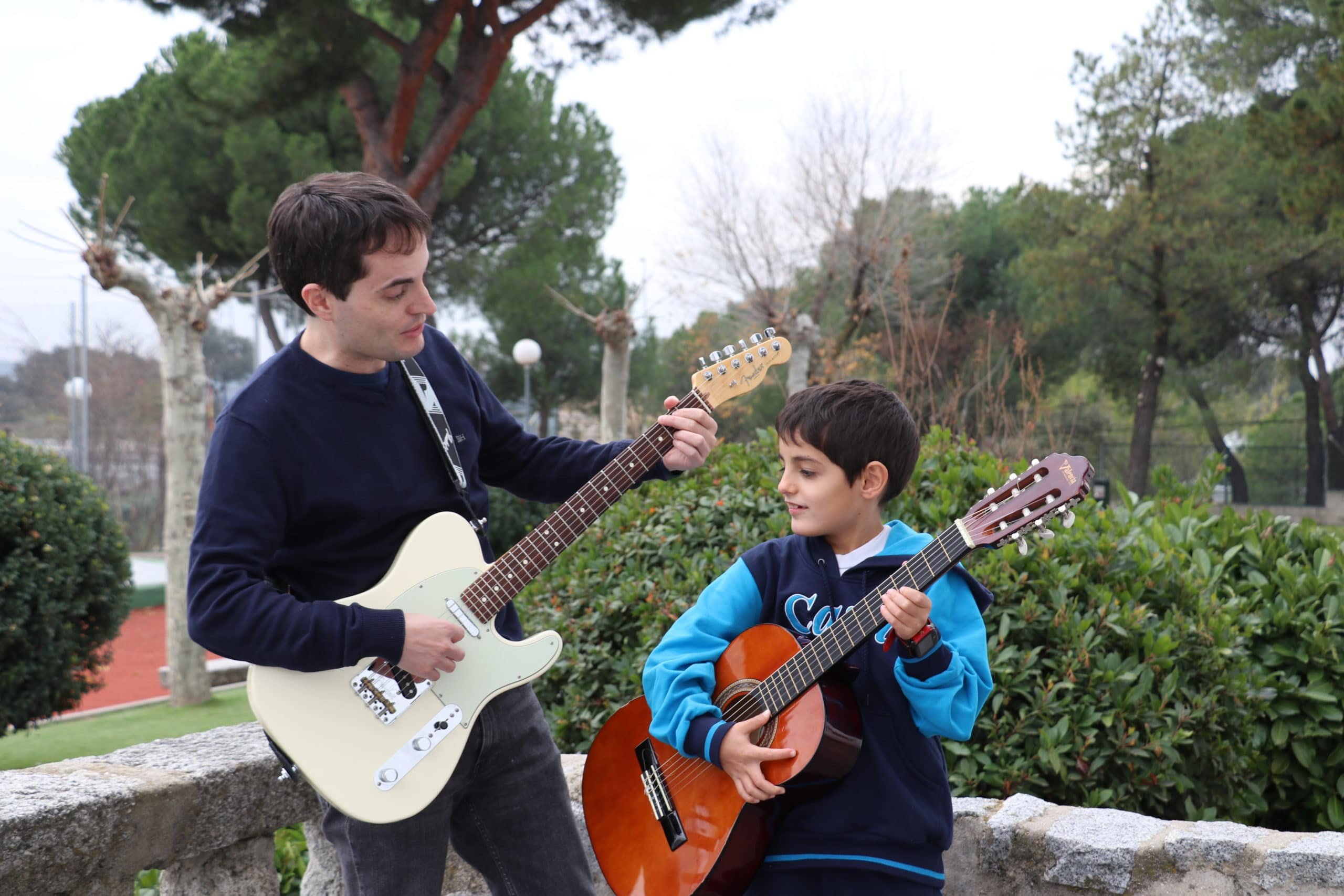 a family playing the guitar